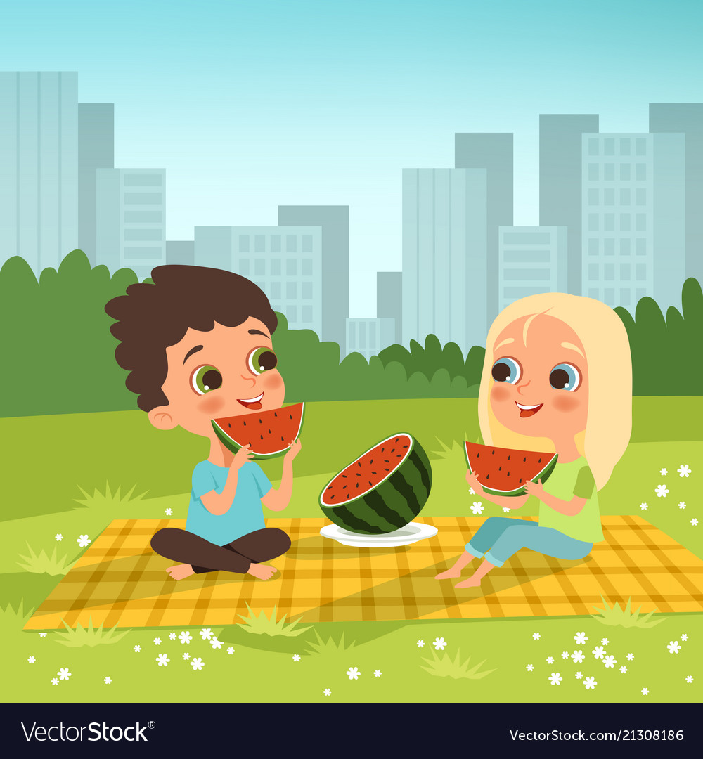 Kids couple sitting in the urban garden and eat