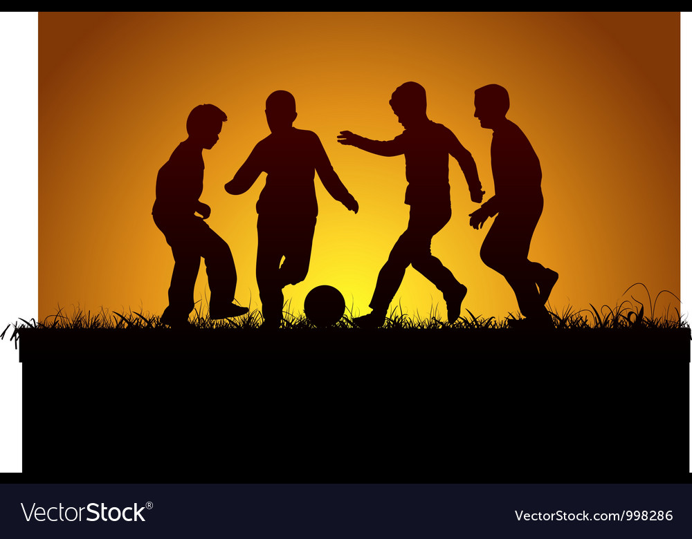Four boys playing football
