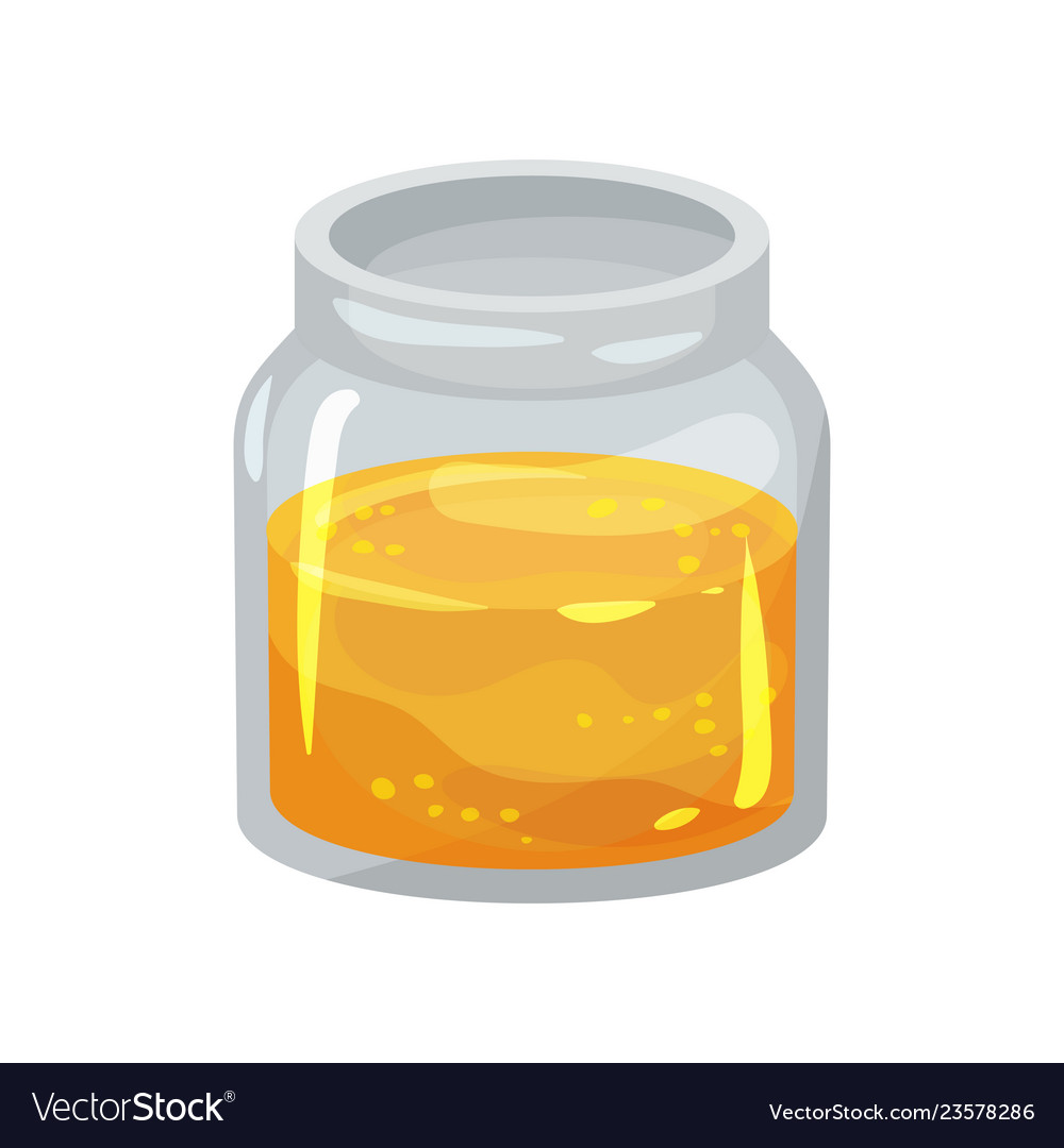 Small open glass jar with fresh honey natural
