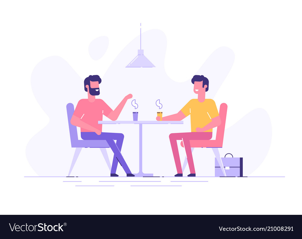 Two male colleagues chatting during coffee break
