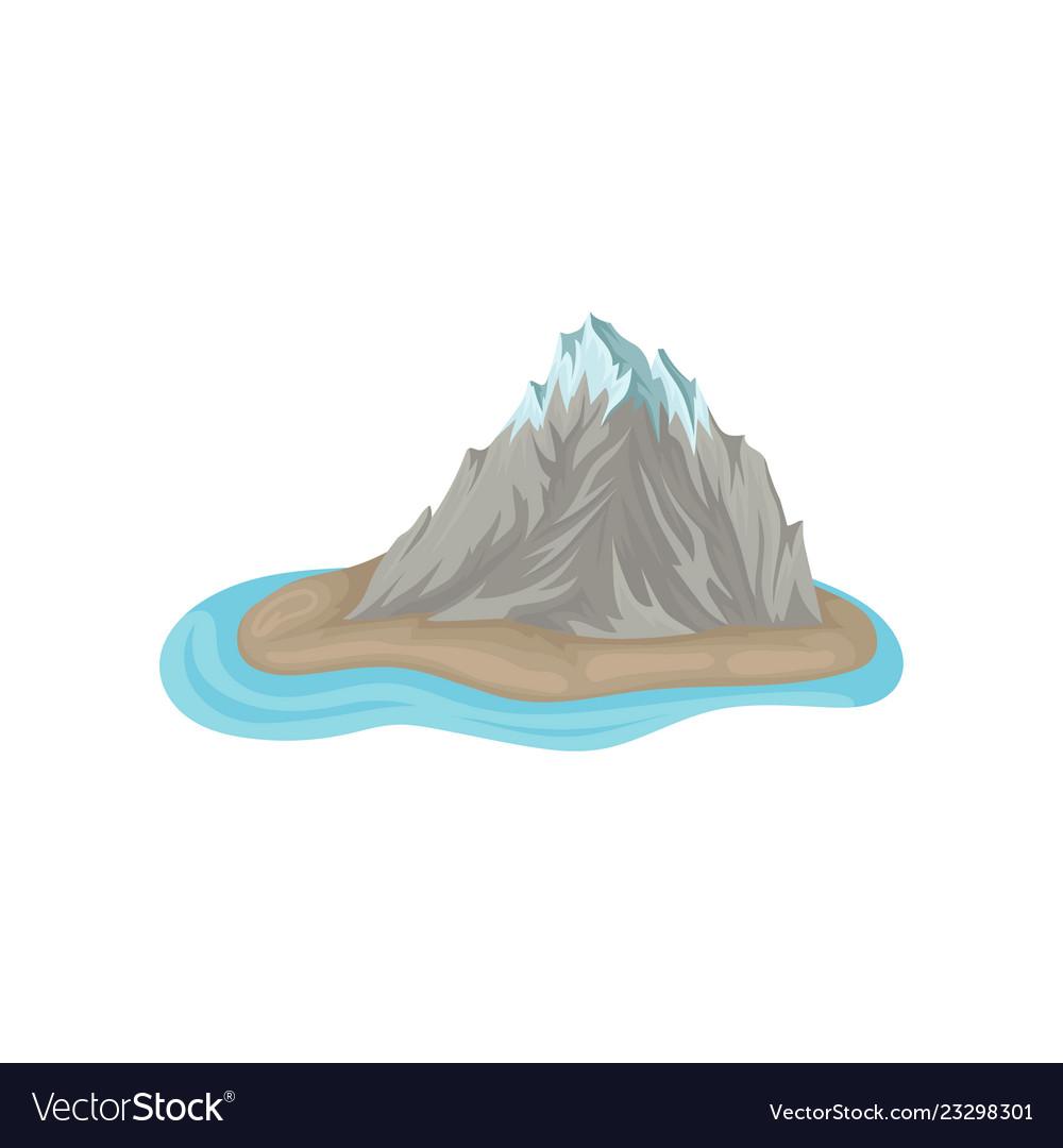 Gray rocky mountain with snowy peak on island