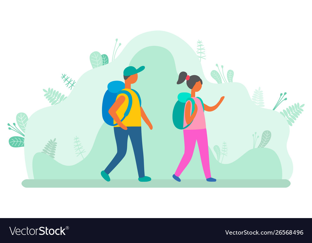 Man and woman with backpacks walking green leaves