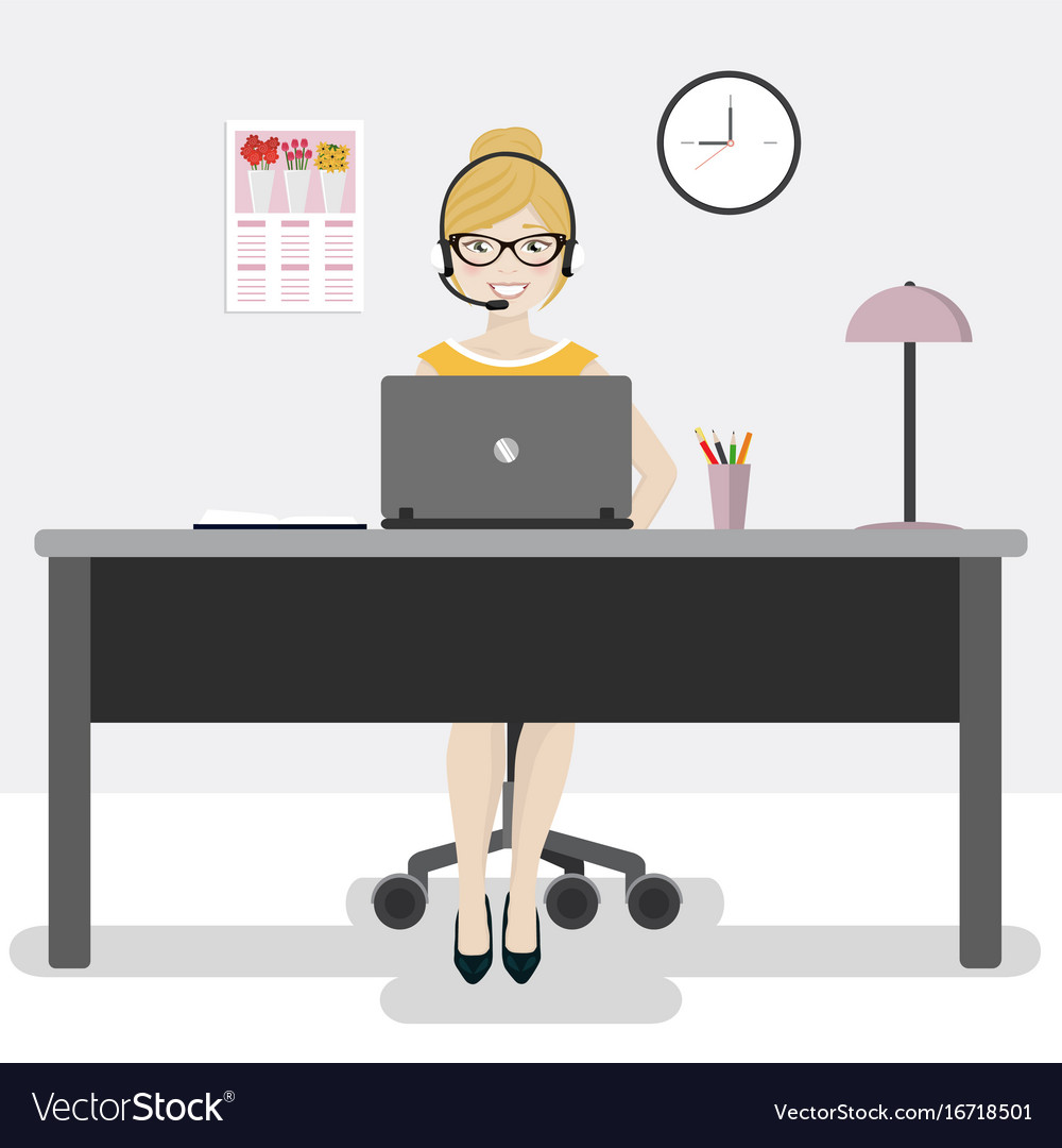 Female office worker with laptop and headphones