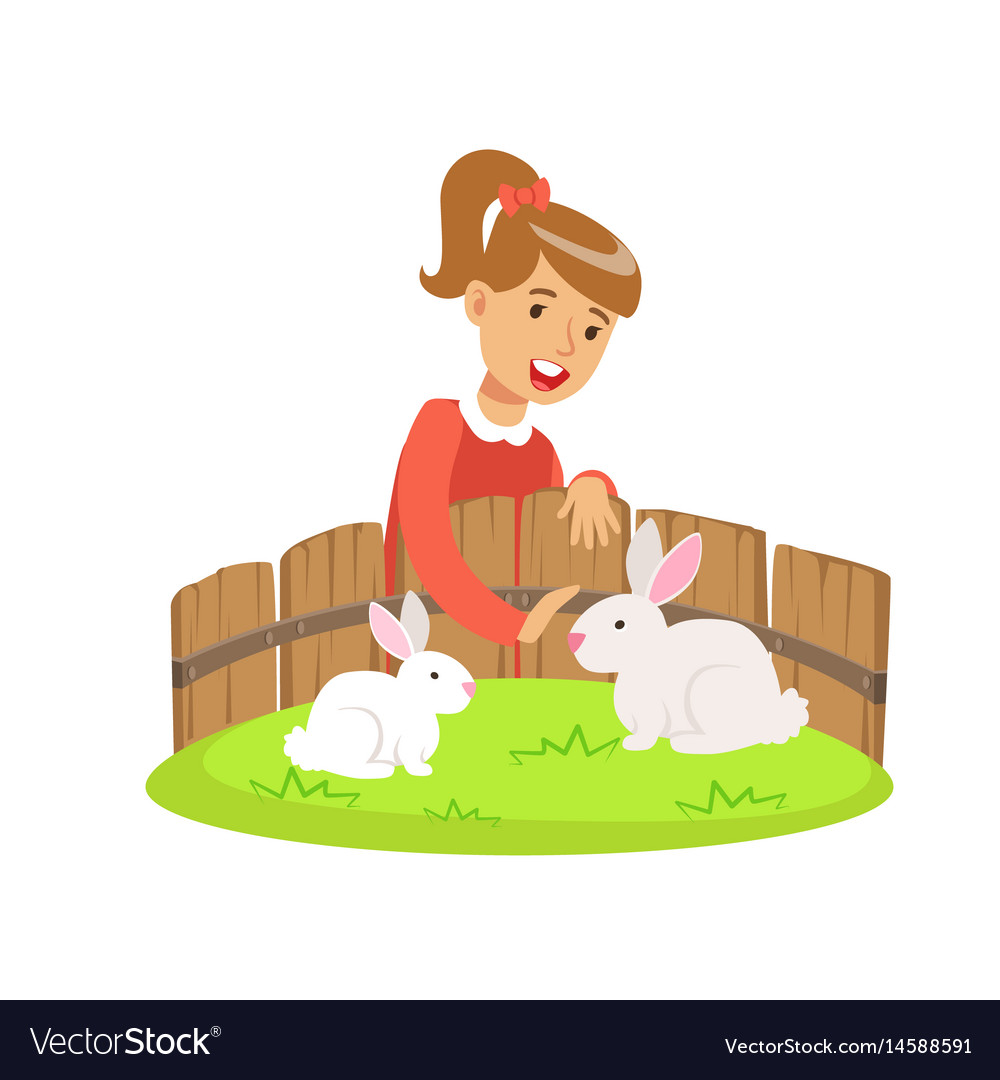 Smiling little girl petting two white rabbits in a