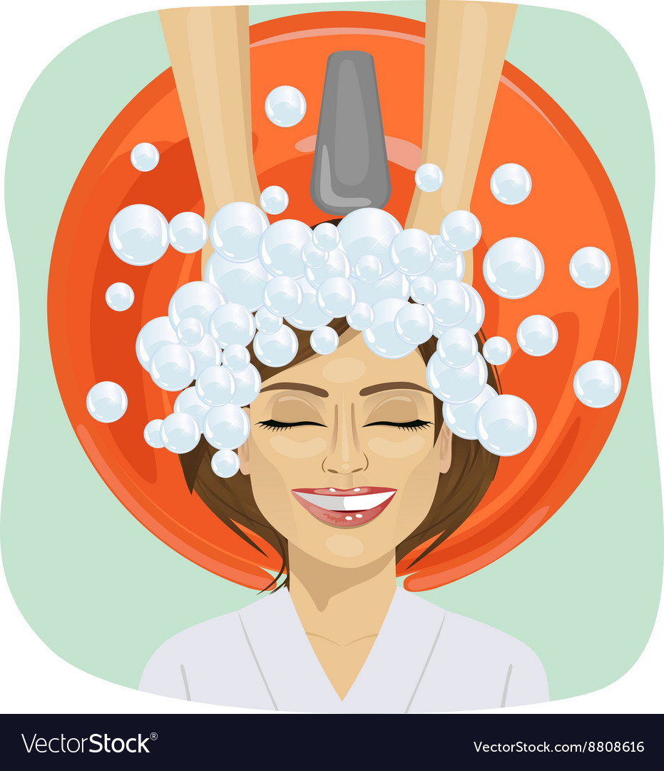 Hair washing at hairdressing salon young girl