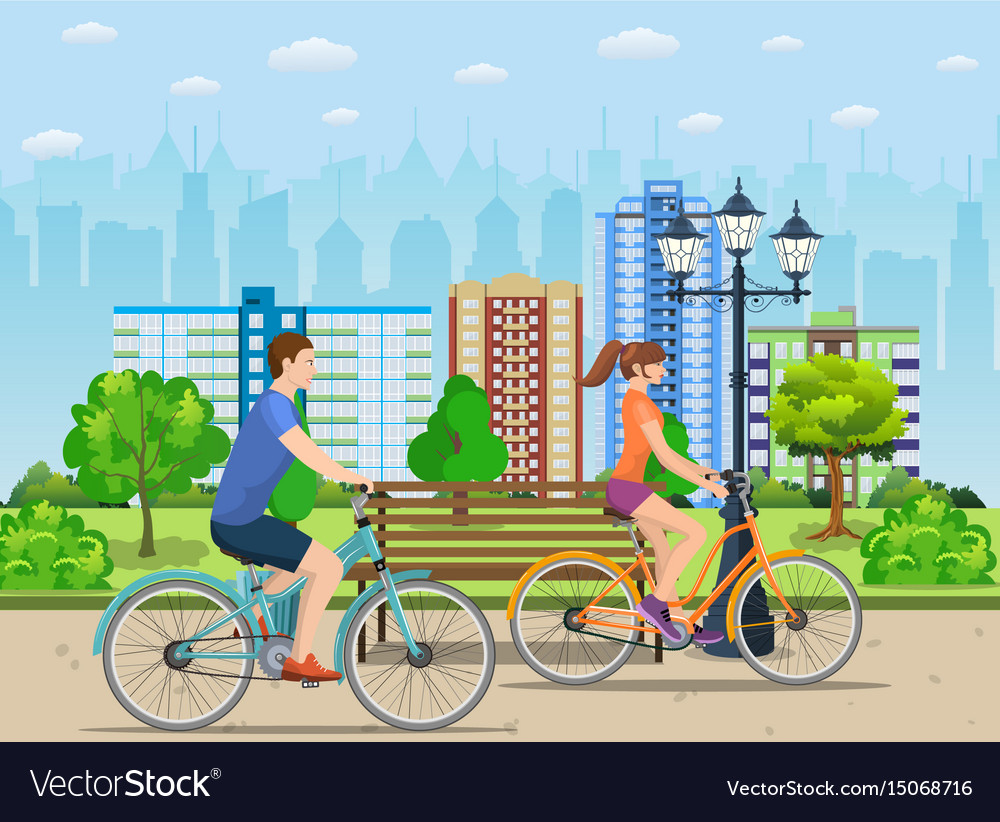 Couple riding bicycles in public park