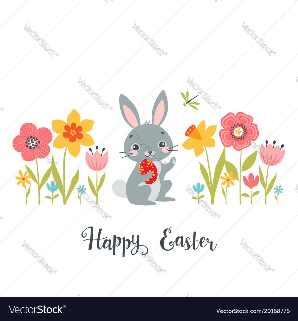 Easter bunny among spring flowers
