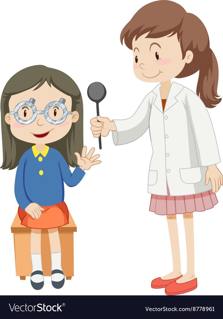 Girl having eye checked by doctor