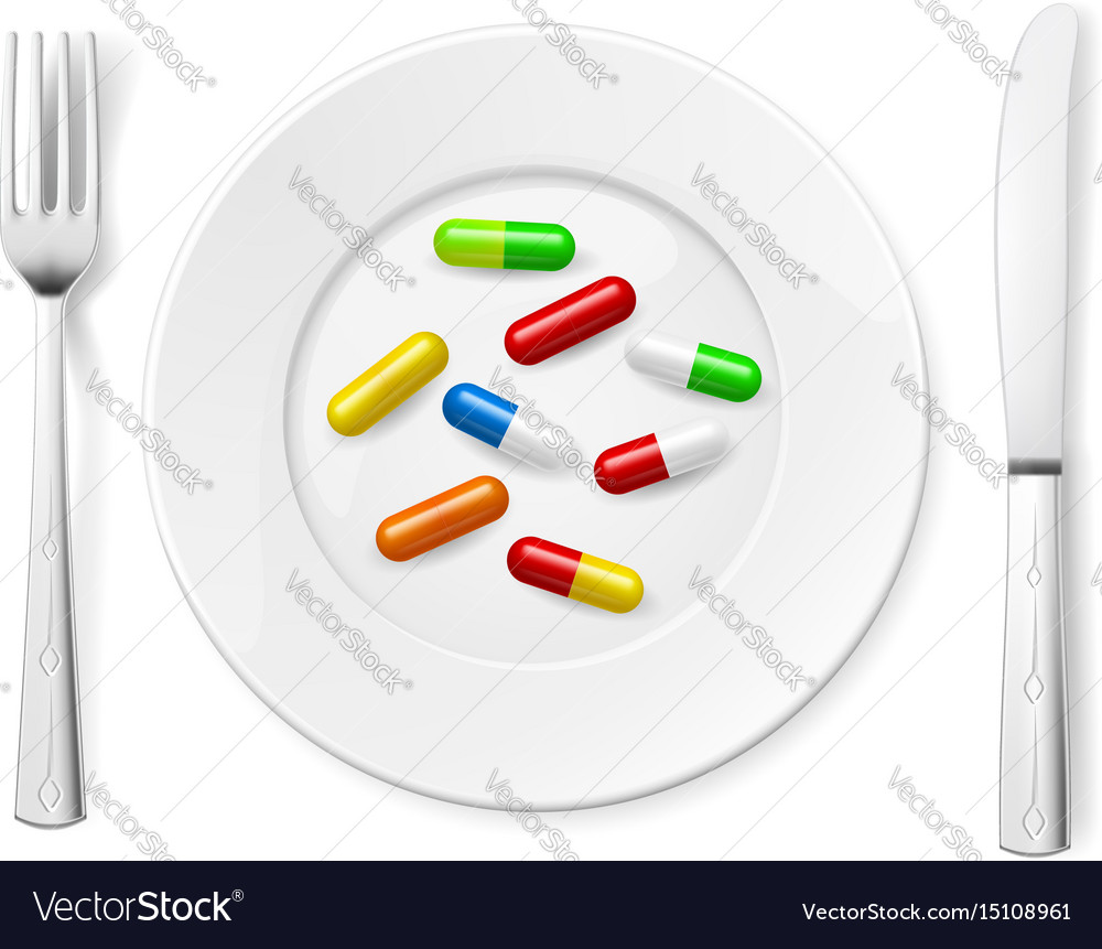 Medical pills on white plate with knife and spoon