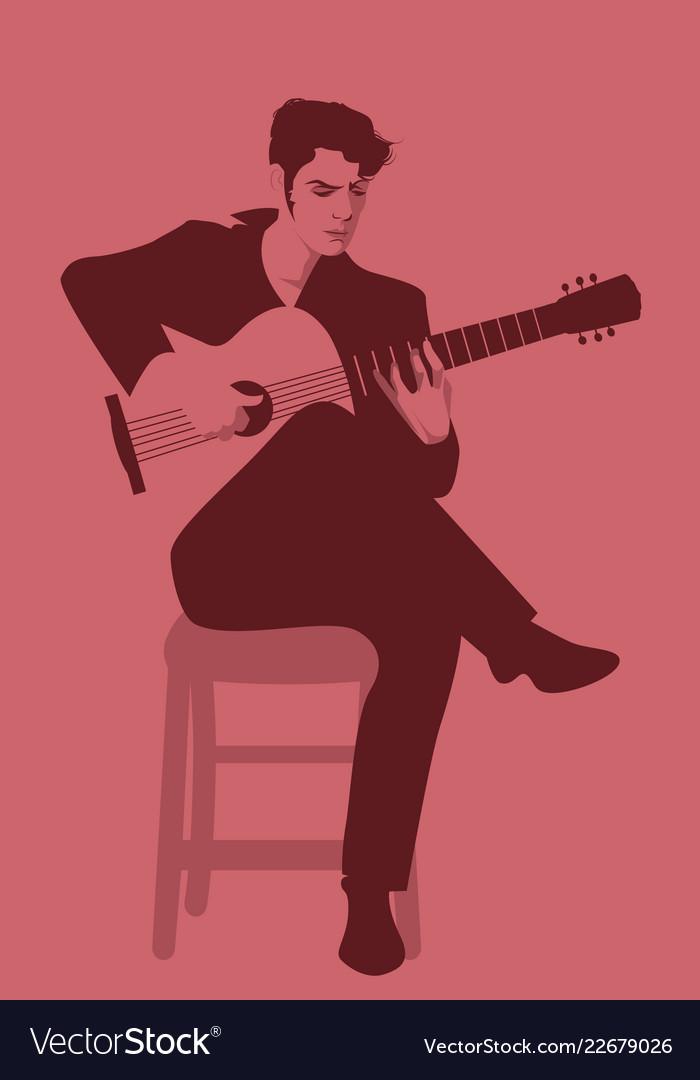 Spanish guitarist playing flamenco sitting on a