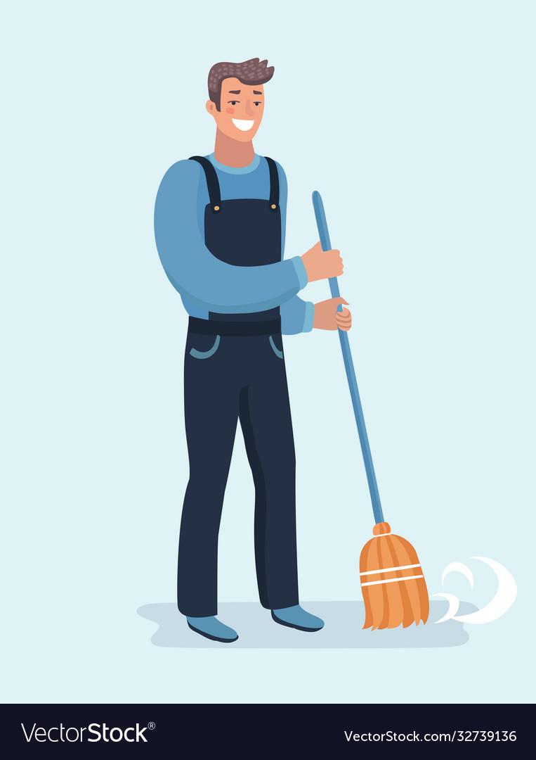 Janitor sweeping fallen leaves