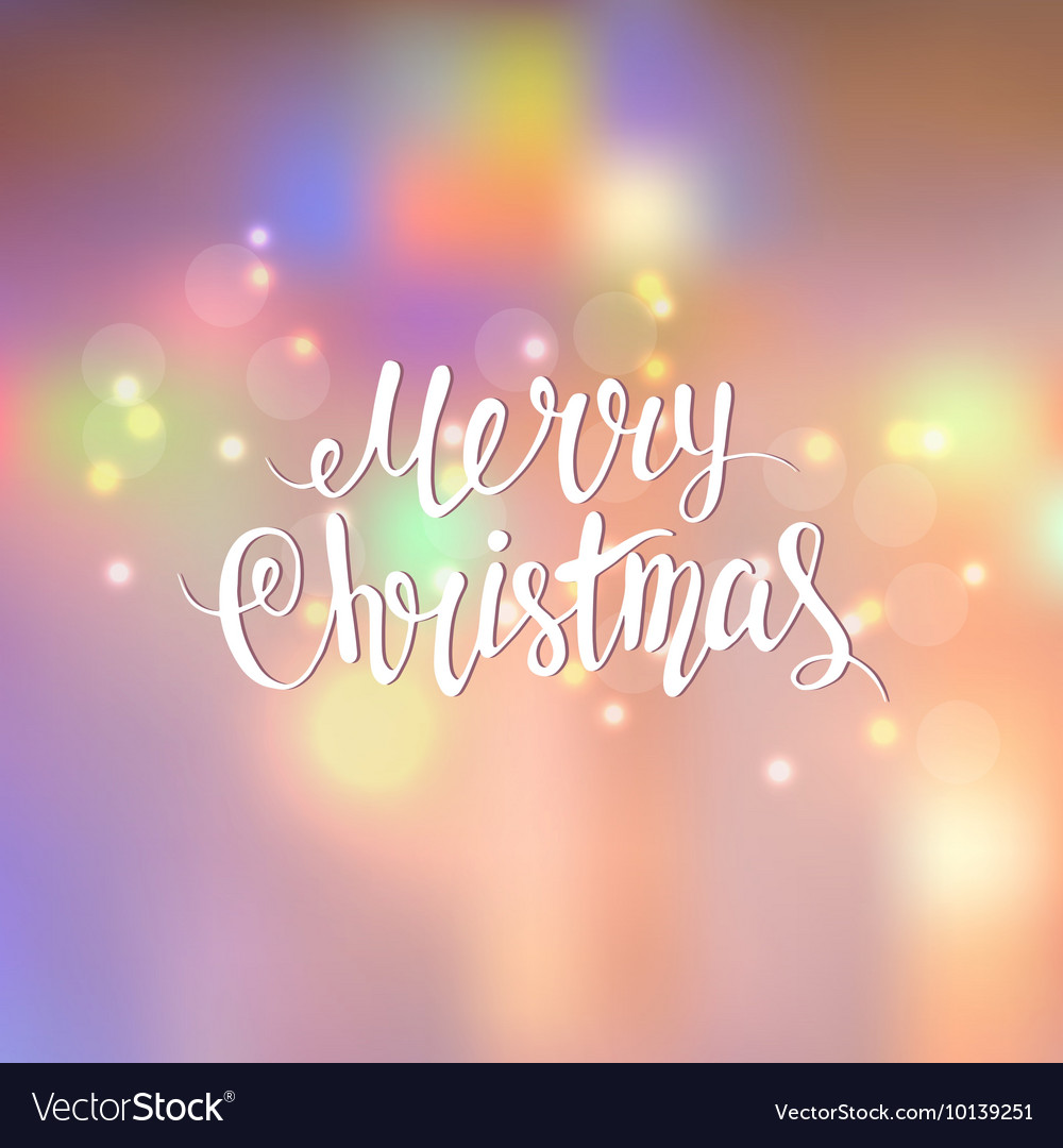 Merry Christmas lettering a blurred background