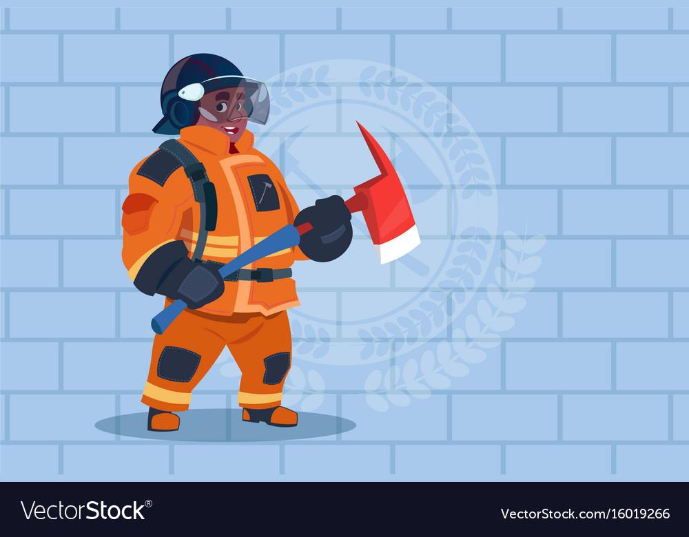 African american fireman holding hammer wearing