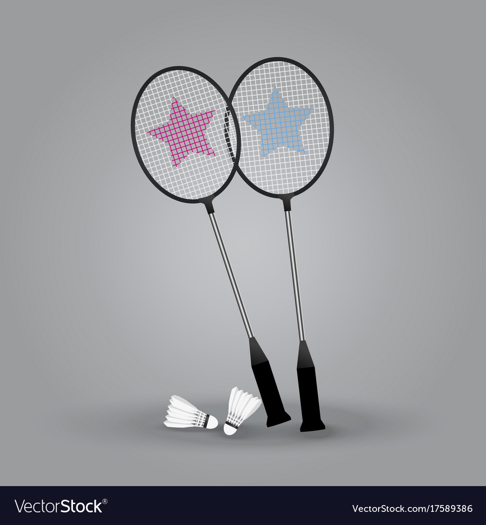 Two badminton rackets with shuttlecock on gray