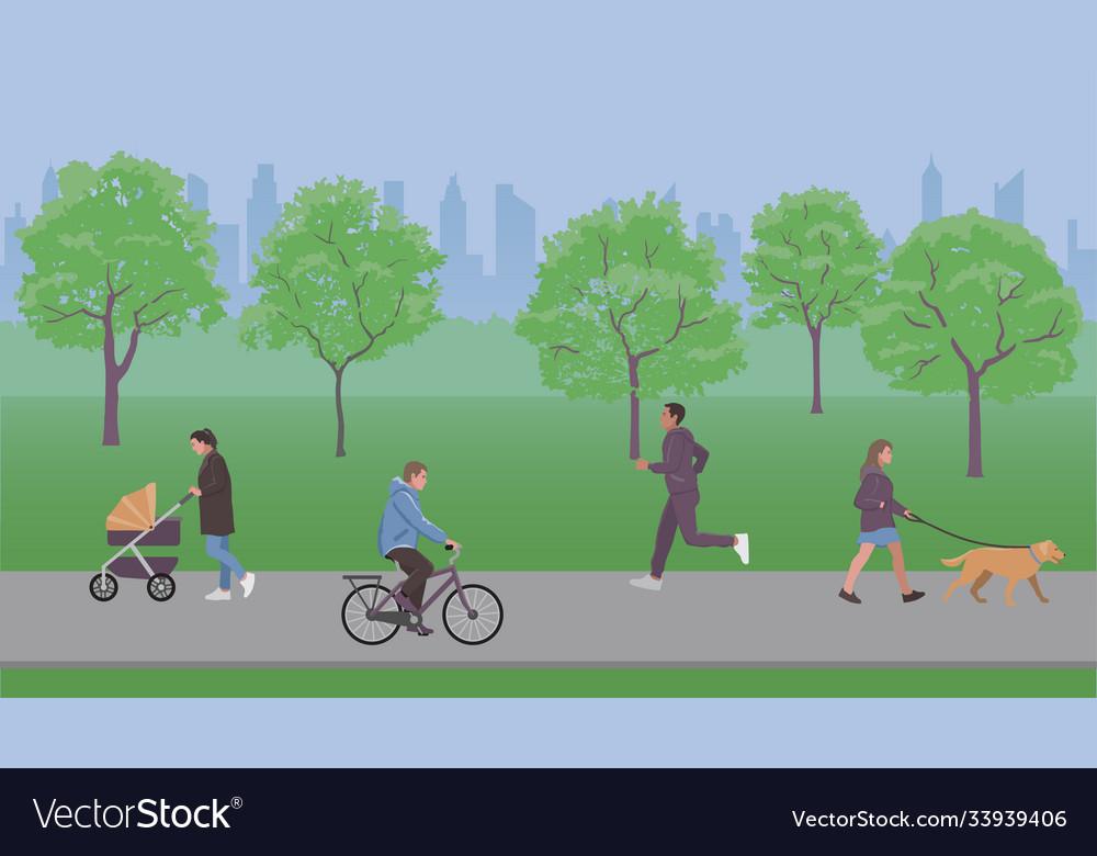 People walk in city park