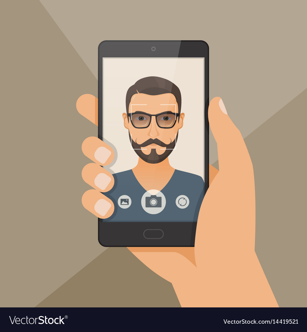 Hipster bearded young man takes selfie using a
