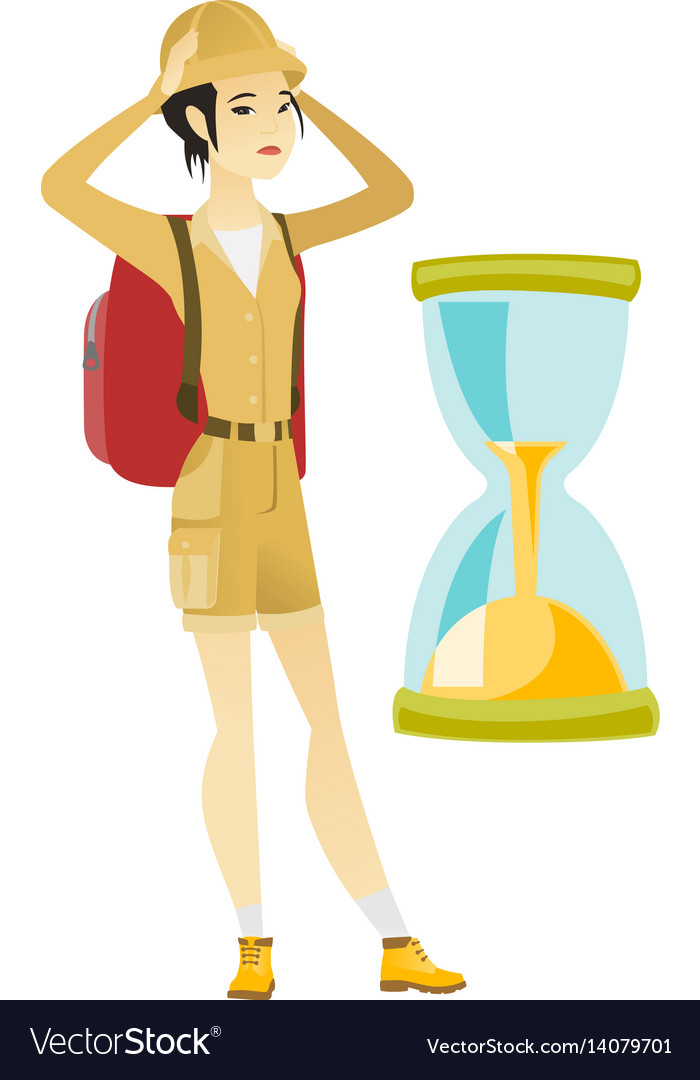 Worried asian traveler woman looking at hourglass
