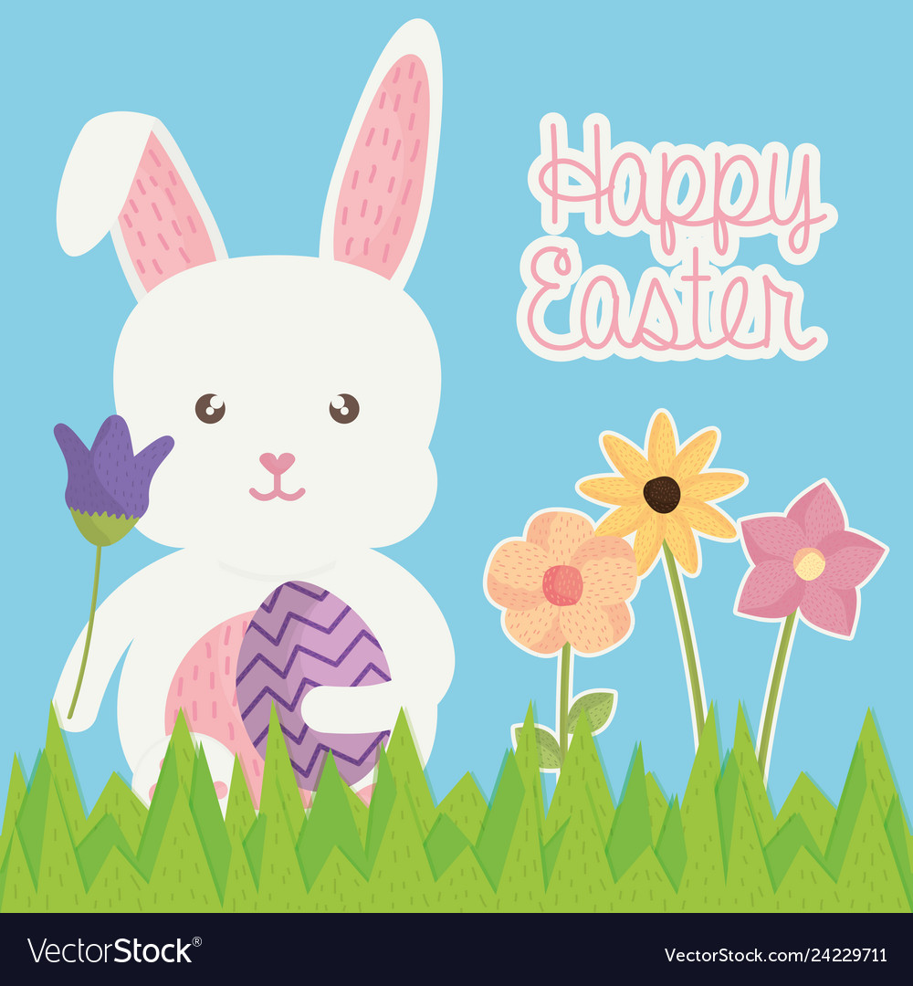 Cute rabbit with easter egg painted in the