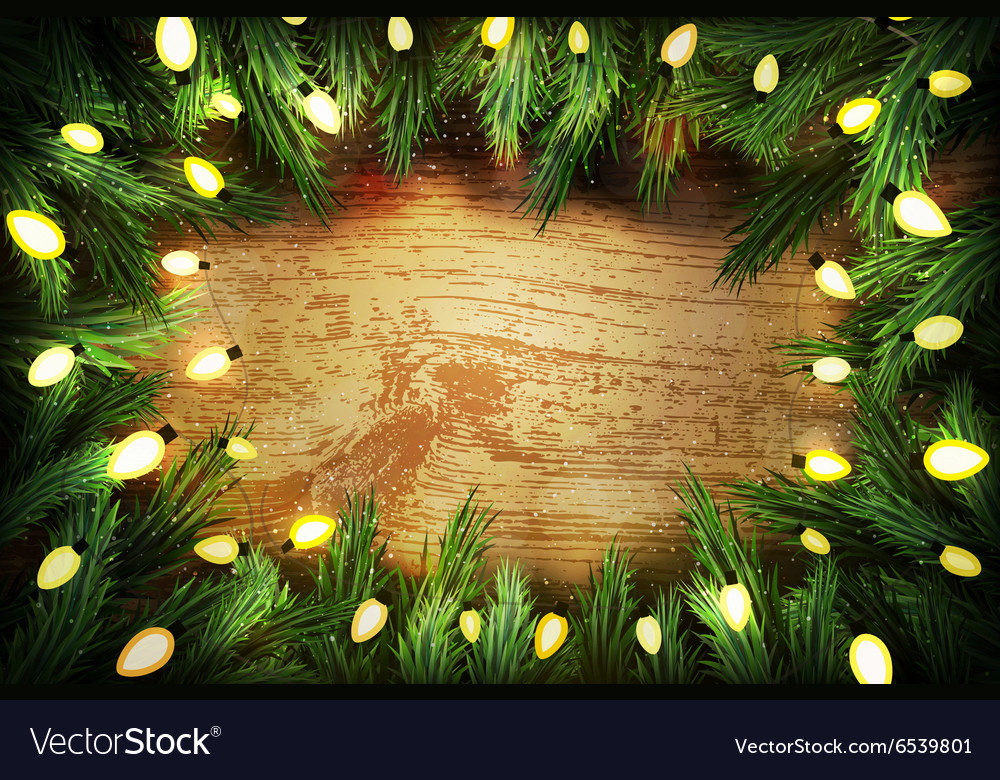 Christmas pine wreath with lights on wooden backgr