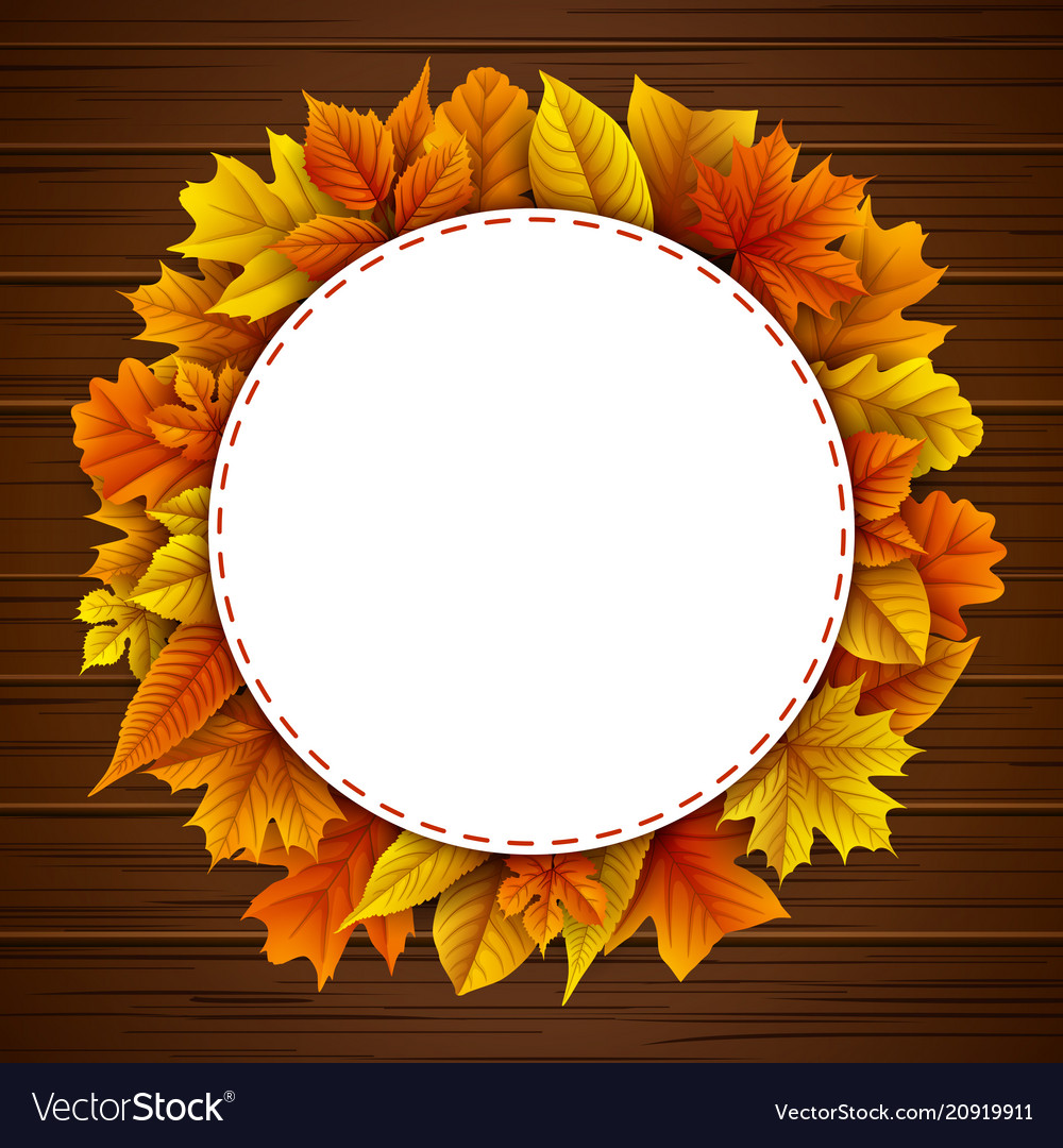 Round frame with autumn leaves wooden background