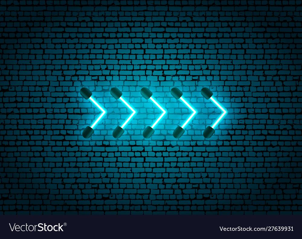 Blue neon glowing arrow pointer on dark brick wall