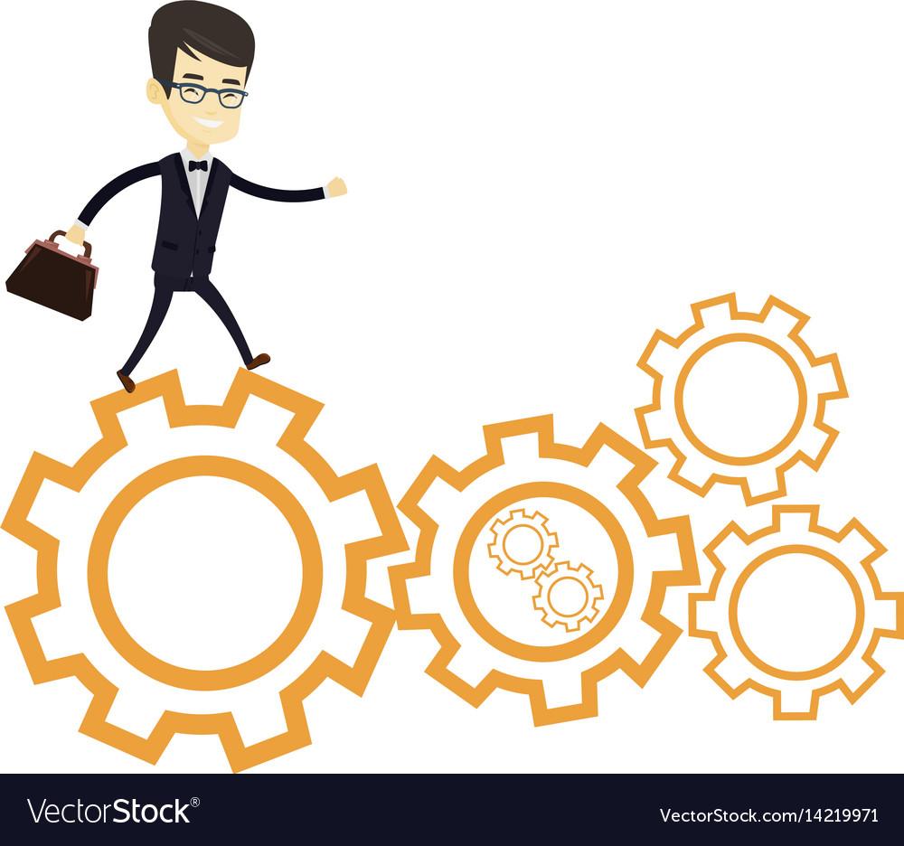 Business man running on cogwheels