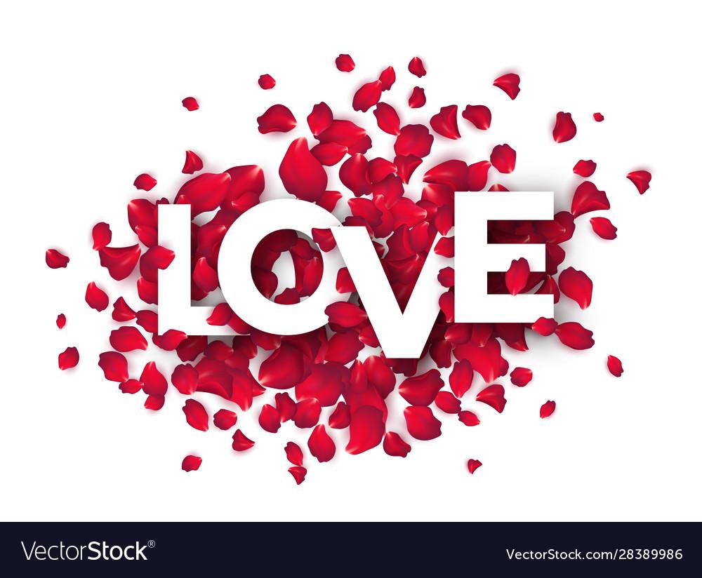 Paper cut word love on a backdrop rose petals