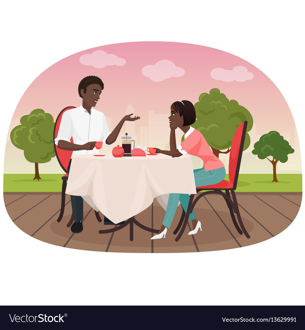 An african couple sitting in the cafe outside and
