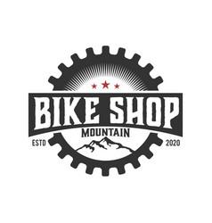 Bikeshop bicycle gear logo design workshop garage vector