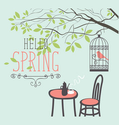 Spring street cafe under tree with bird in cage vector