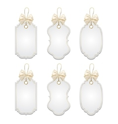 Set of elegant tags with silver and golden bows vector image