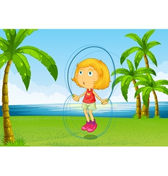 A girl playing skipping rope at the riverside vector image vector image