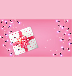 pink gift box and lights garland realistic vector image
