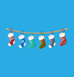 christmas stockings in various colors on rope vector image