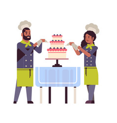 cooks couple professional pastry chefs decorating vector image