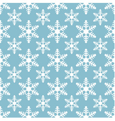white snowflakes seamless pattern on blue vector image