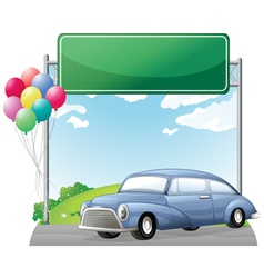 A car and balloons with an empty signboard vector image