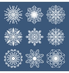 Set of 9 hand drawn symmetric white snowflakes vector image