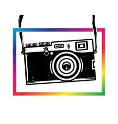 Vintage photo camera out of colorful frame vector