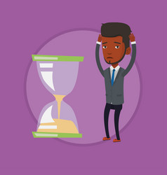 desperate businessman looking at hourglass vector image vector image