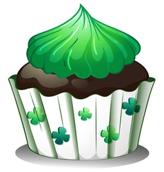 A chocolate cupcake with green toppings vector image