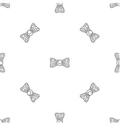 dotted bow tie pattern seamless vector image