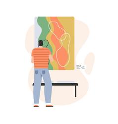 Man at museum modern art watching an abstract vector