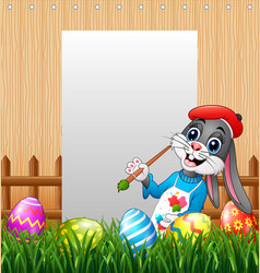 happy easter bunny painting egg with blank sign ba vector image