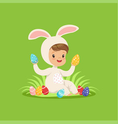 Sweet little boy in a white bunny costume sitting vector