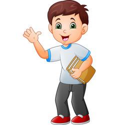 cartoon little boy holding book vector image