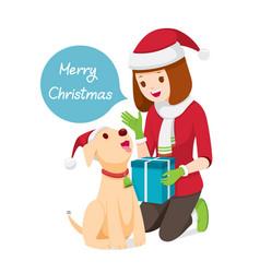 woman giving her dog gift for christmas vector image