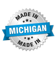 made in Michigan silver badge with blue ribbon vector image