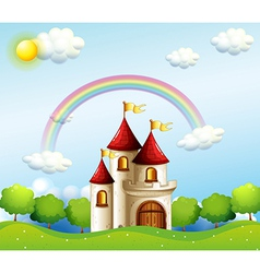 A castle below the rainbow vector image vector image