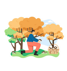 Man picking edible mushroom in autumn forest vector
